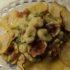 Gnocchetti con farina di riso e pesto di zucchine su un letto di patate al forno
